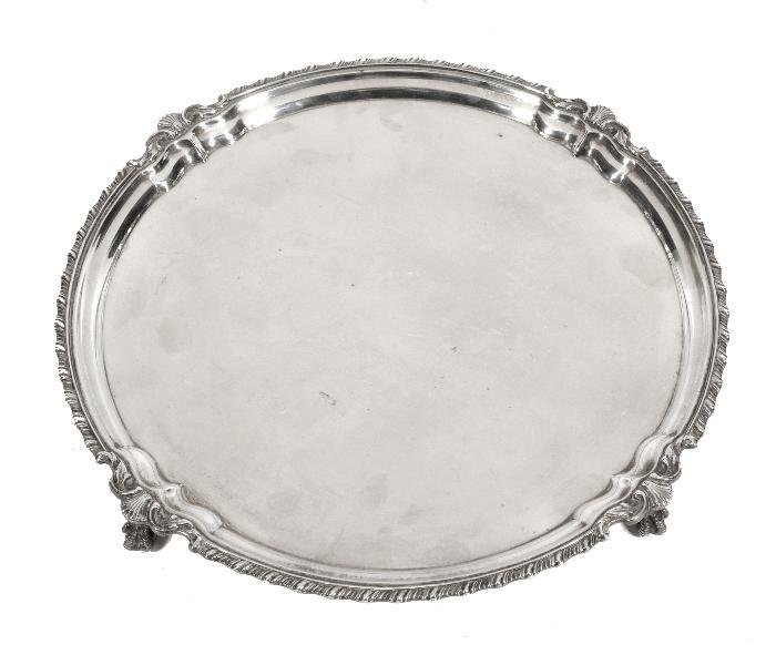 A silver shaped circular salver by Frank Cobb   Co