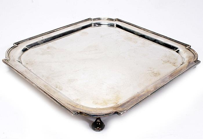 A silver square salver by Thomas Bradbury   Sons L