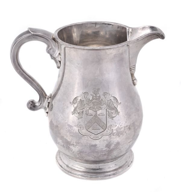 A silver baluster beer jug by the Goldsmiths   Sil