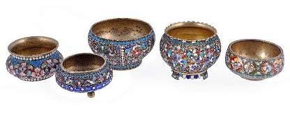 Five Russian silver gilt and enamel circular salt