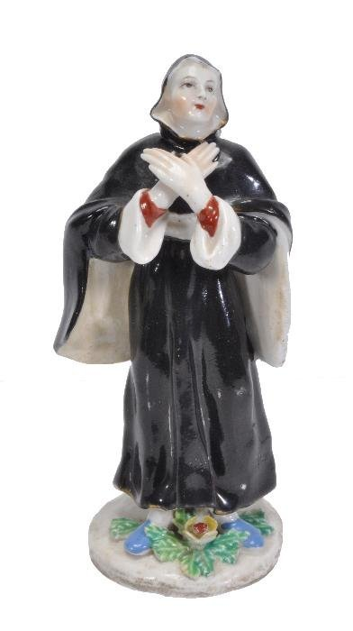A Bow figure of a nun,  on a simple pad base appli