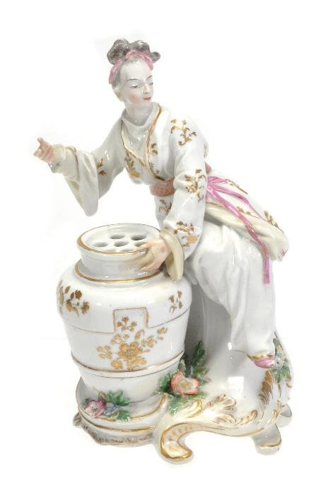 A Chelsea chinoiserie bouquetiere figure of a lady