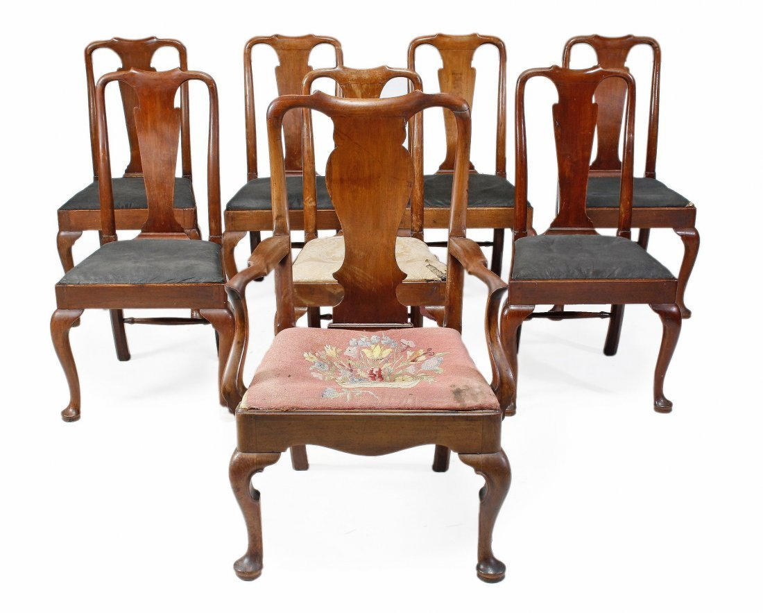 A matched set of eight George I walnut dining chai