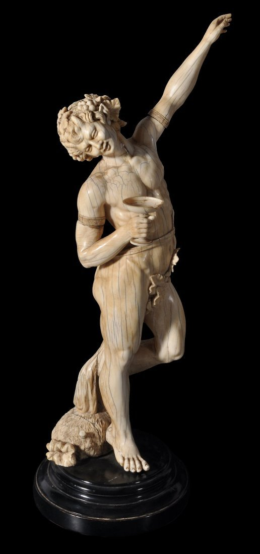A Continental sculpted ivory model of a Faun with