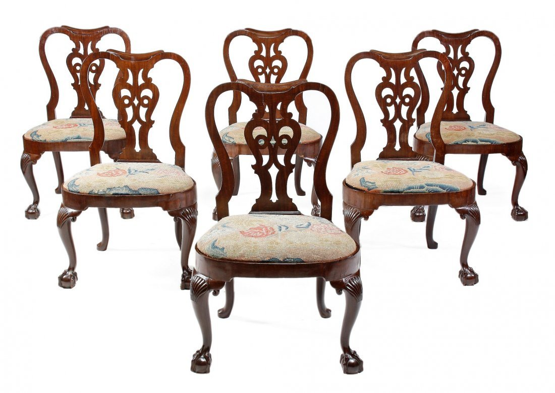 A set of six George II red walnut chairs, circa 17