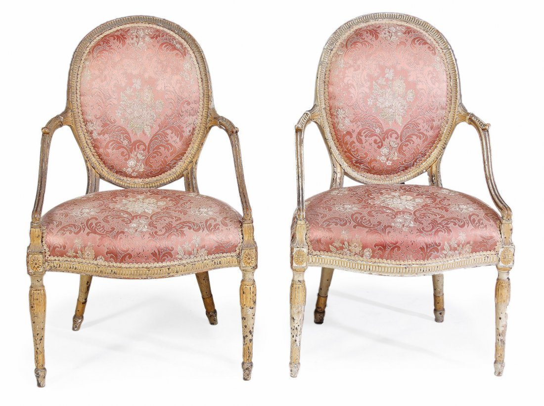 A pair of George III carved cream painted and upho