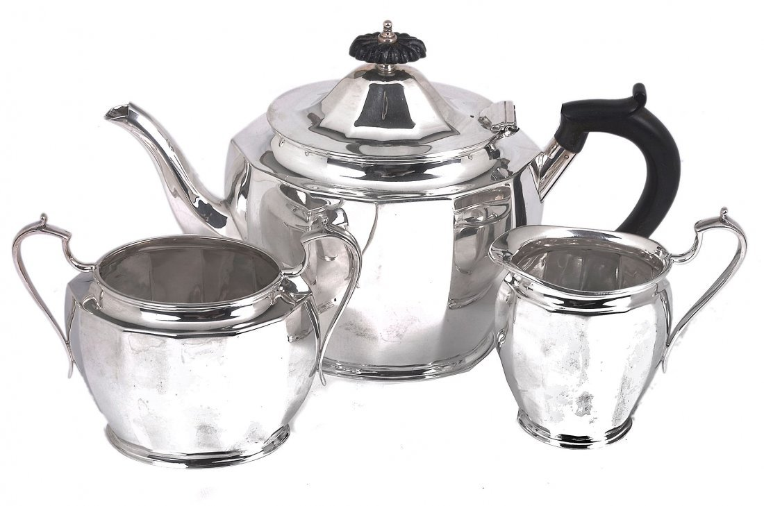 A silver oval faceted three piece tea service by E