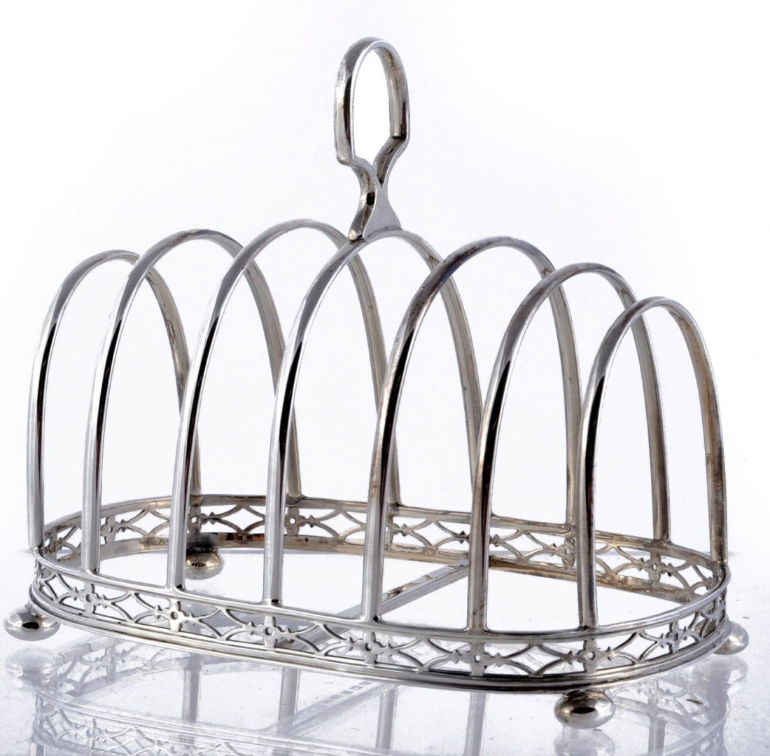A silver six division toast rack by Docker & Burn