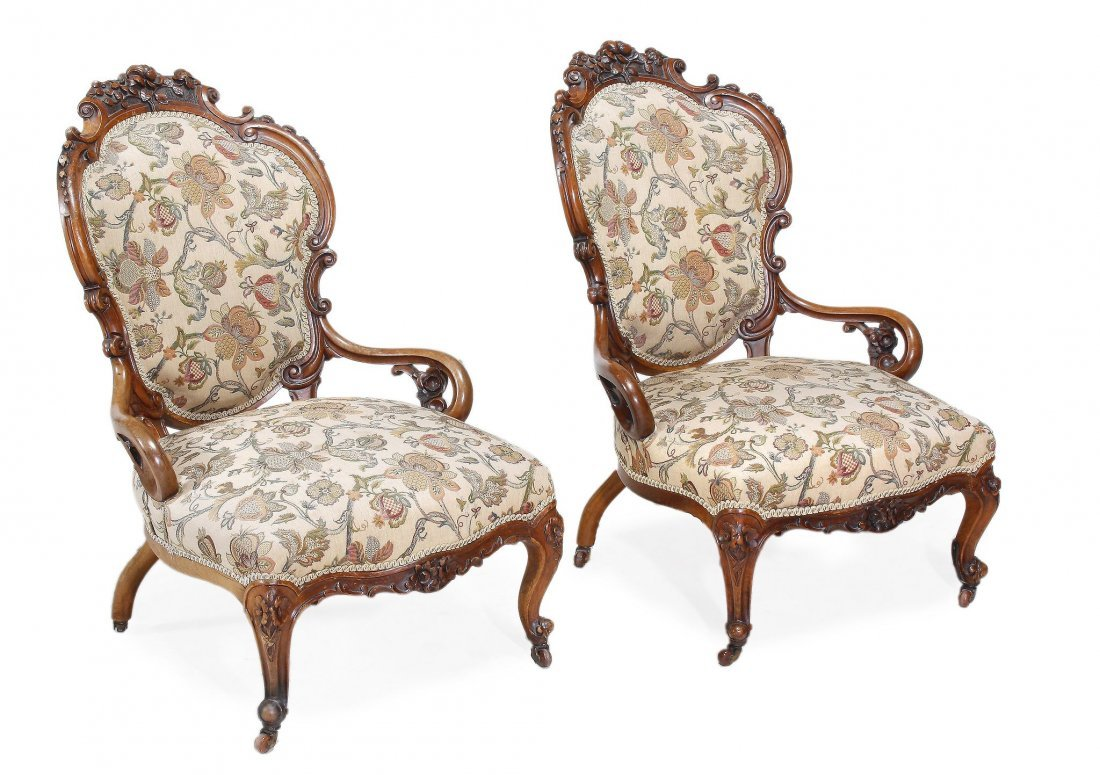 A pair of Victorian walnut and upholstered low cha