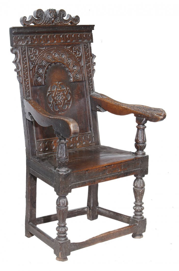 An oak panel back armchair , circa 1660 and later