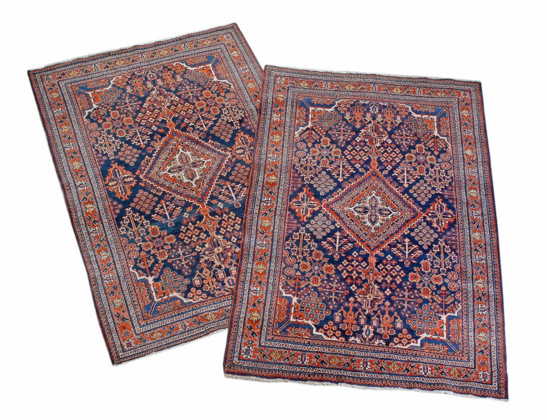 A pair of Afshar rugs, the indigo field with a cen