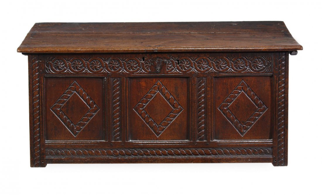 An oak coffer, 17th century, the hinged rectangula