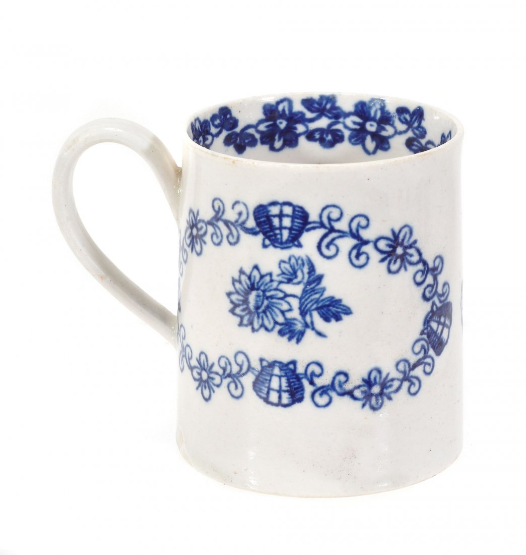 A Liverpool blue and white mug, printed with two floral