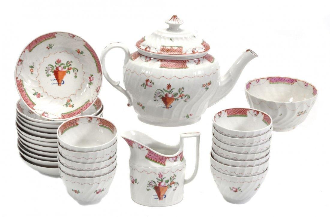 An English porcelain spirally-fluted part tea service