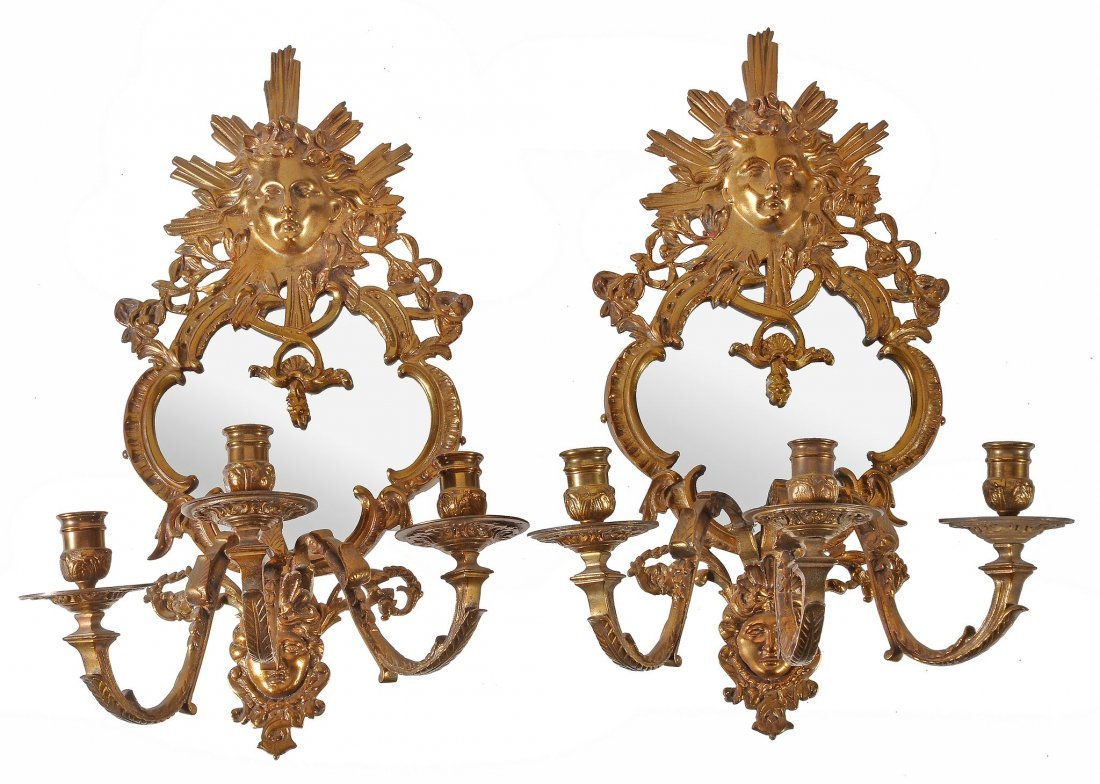 A pair of Continental gilt metal and mirrored glass
