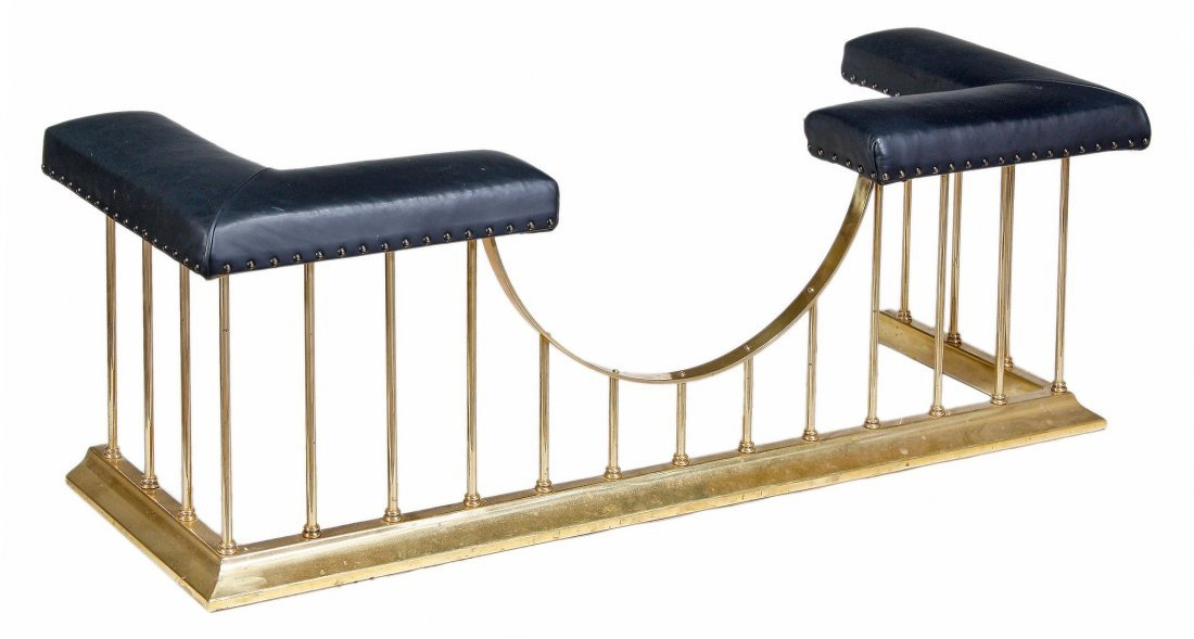 A brass and black leather upholstered club fender, 20th