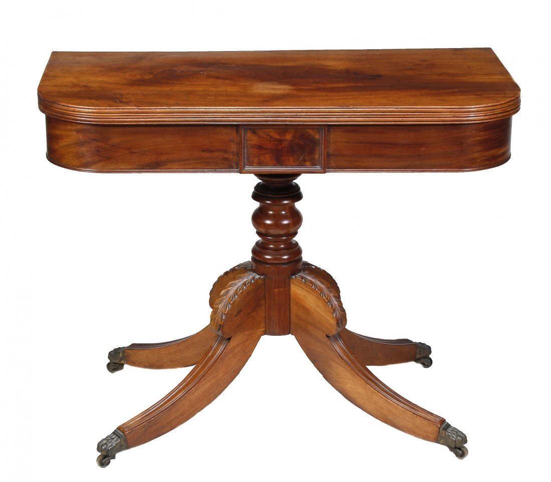 A George IV mahogany folding tea table, circa 1825, the