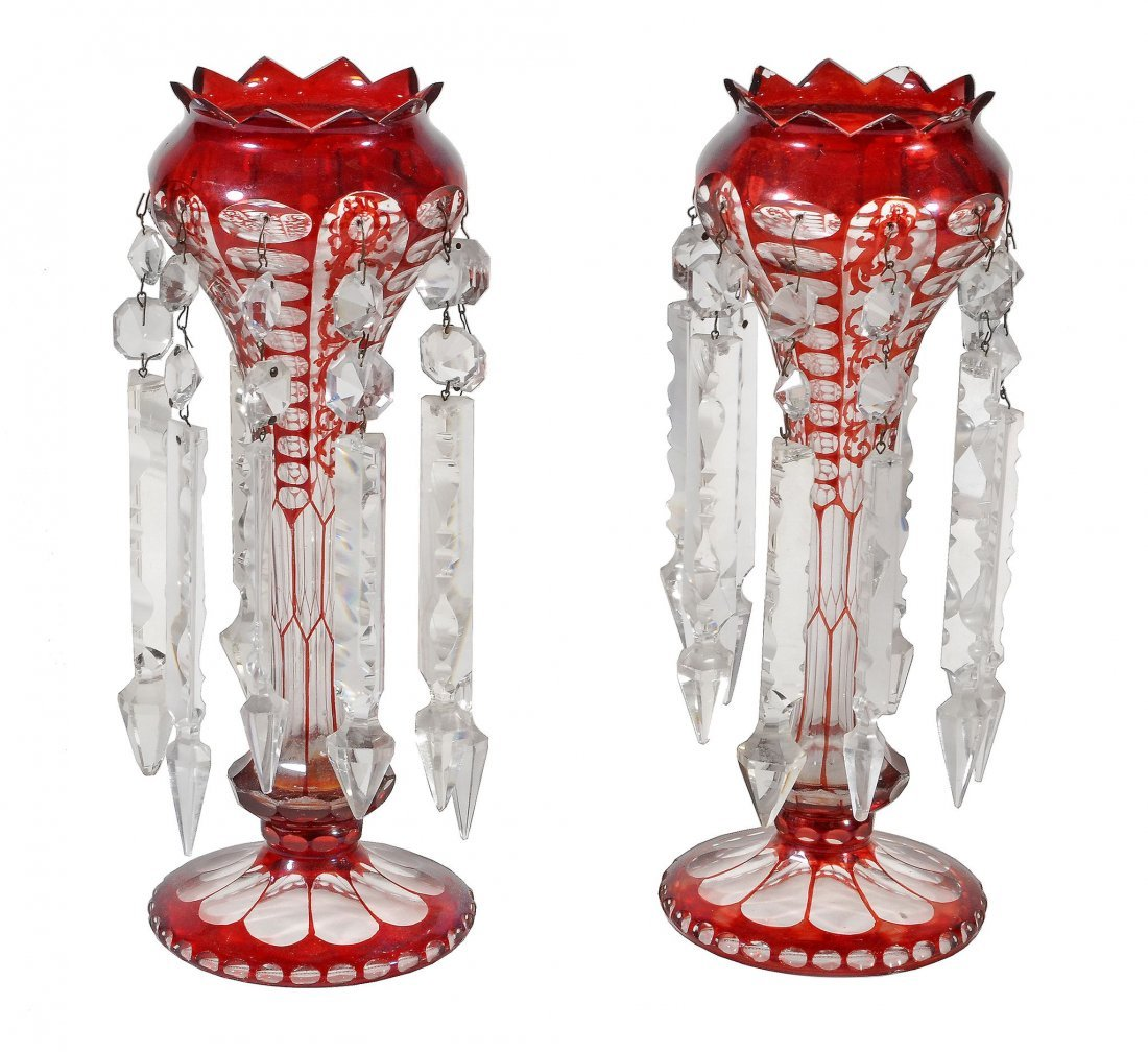 A pair of Bohemian ruby flash, cut and moulded glass
