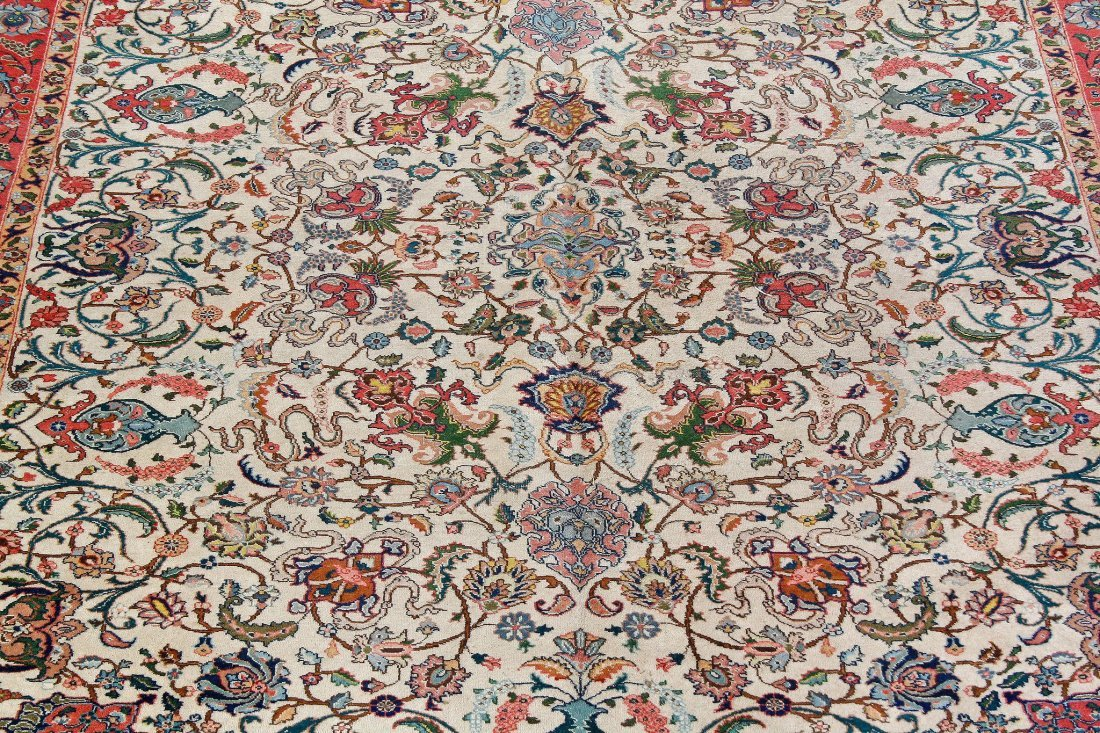 A Tabriz carpet, the ivory field and madder border