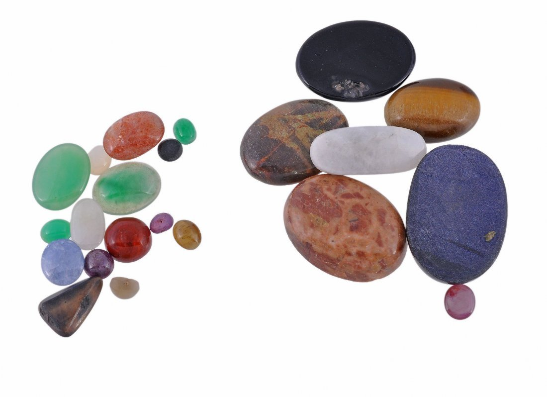 A selection of faceted and cabochon gemstones , to