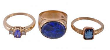 A three stone tanzanite and diamond ring, mount stamped