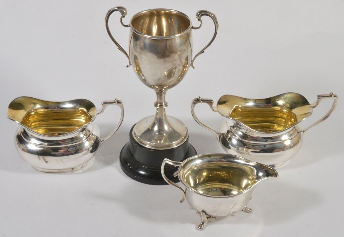 A silver twin handled trophy cup by Charles Boyton &