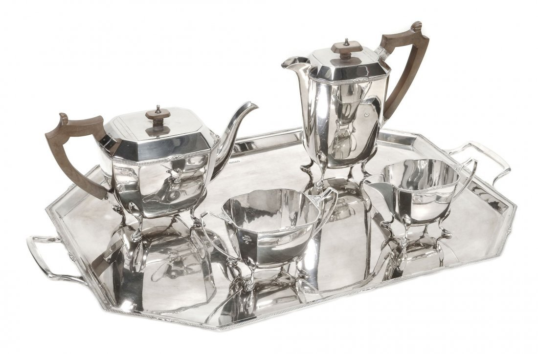 An Art Deco silver three piece tea service by Gladwin