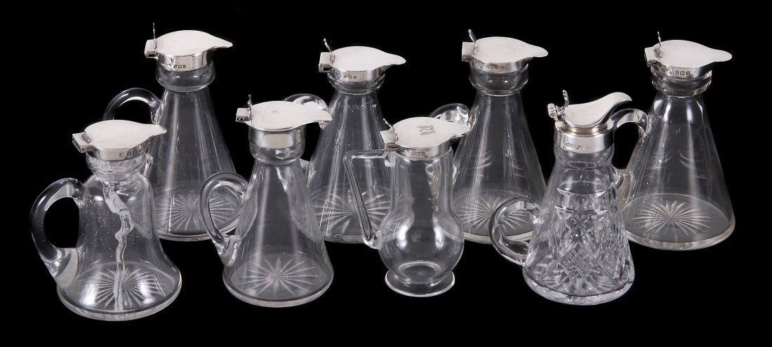 Eight silver mounted clear glass whisky noggins