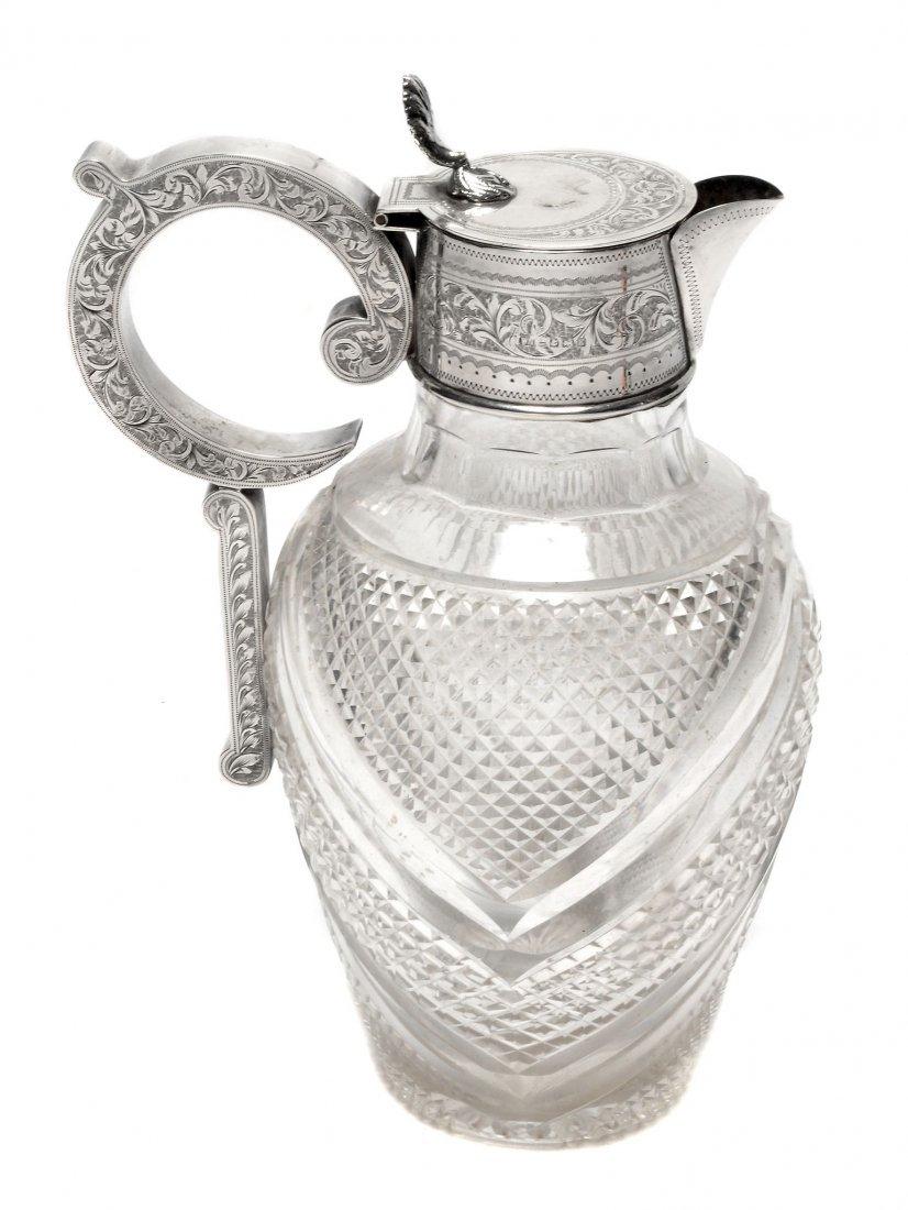 An Edwardian silver mounted cut glass claret jug,