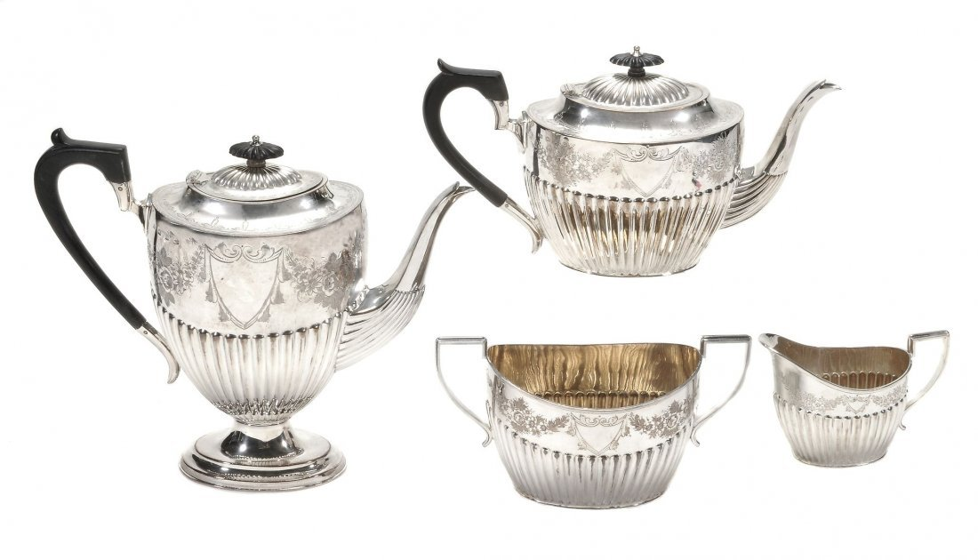 A late Victorian silver oval four piece tea and coffee