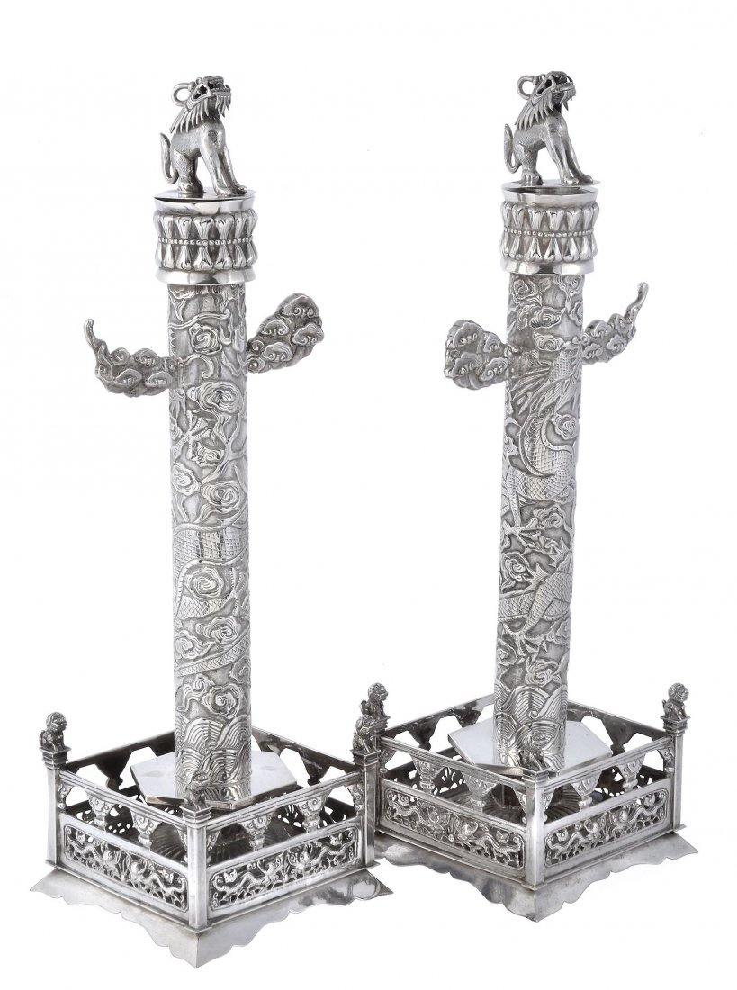 A pair of Chinese export silver models of ceremonial