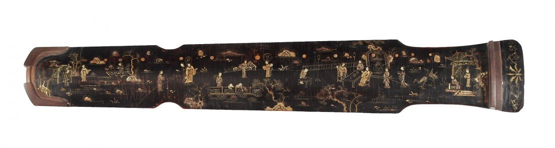 A Chinese lacquered qin , the wood structure covered in