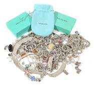 A collection of silver coloured jewellery and costume