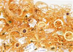 A quantity of gold coloured jewellery, including