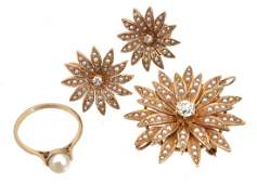 A diamond and seed pearl flower head broochpendant and
