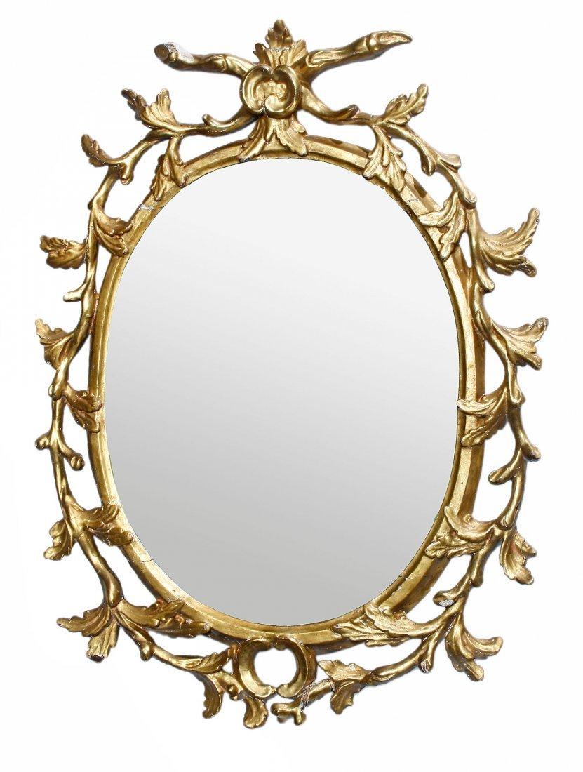 A George III carved giltwood oval wall mirror, circa