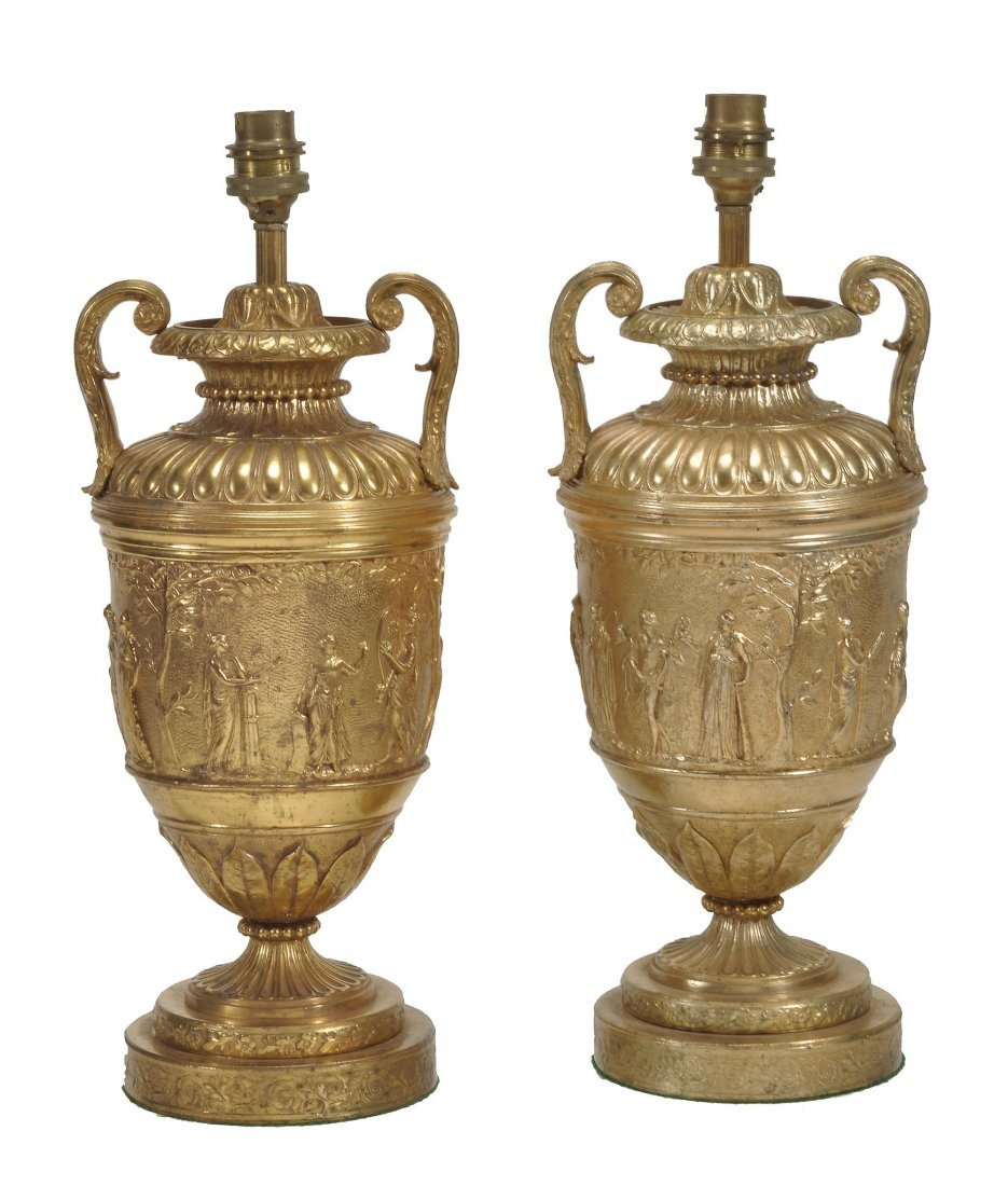 A pair of gilt metal twin handles urns fitted as table