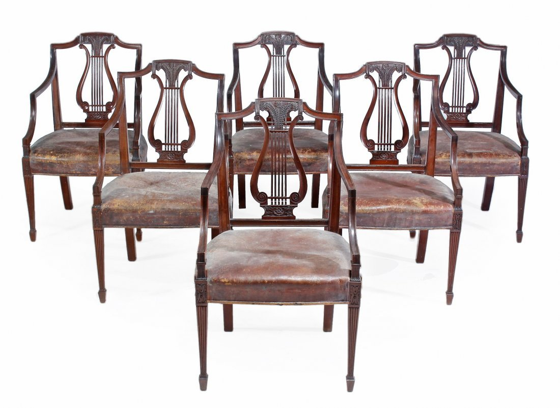 A set of six mahogany elbow chairs, in George III style