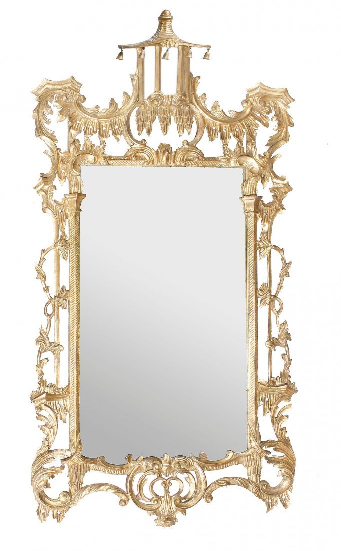 A carved giltwood wall mirror, in George III style,