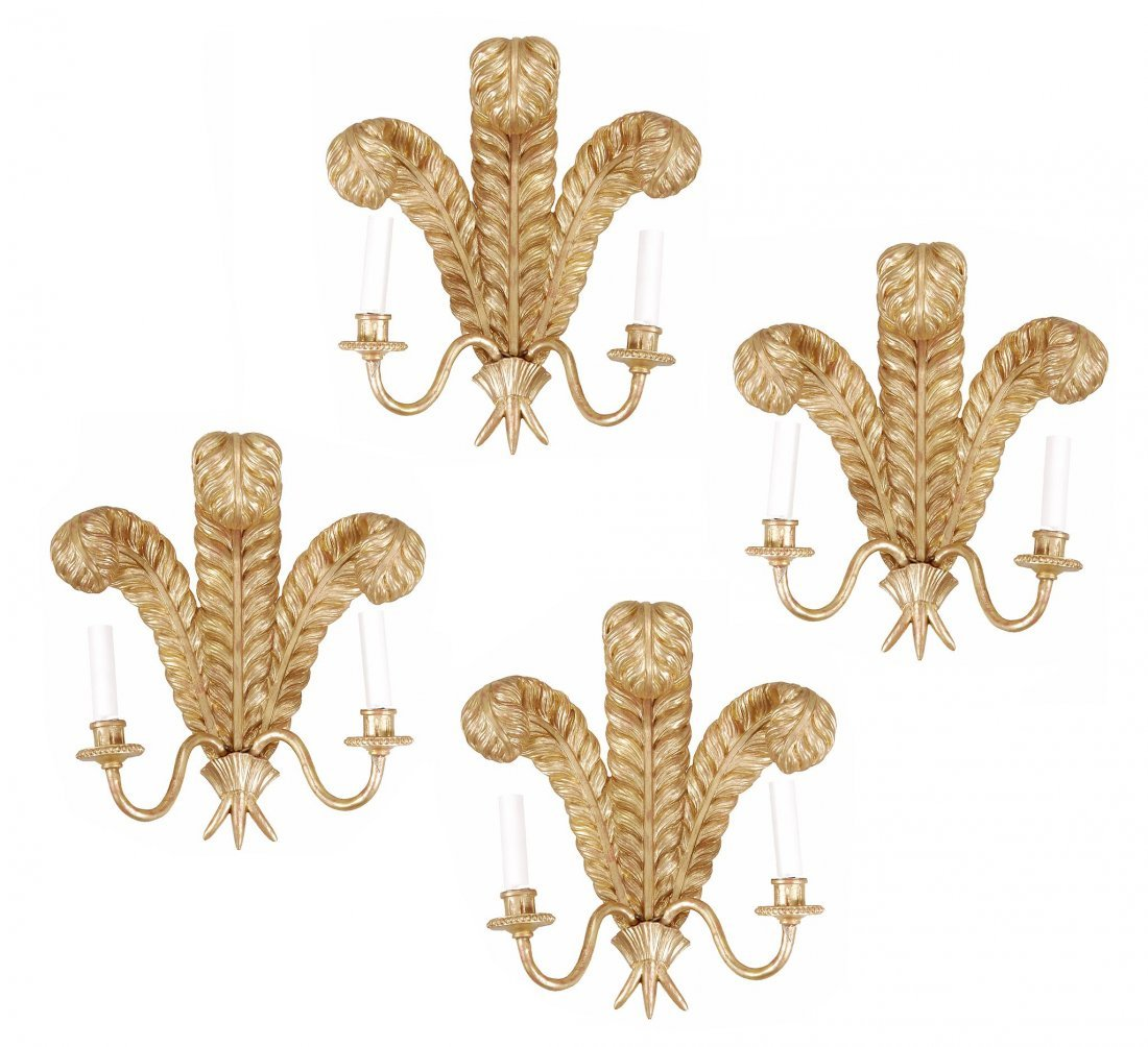 A set of four carved and giltwood and gilt metal