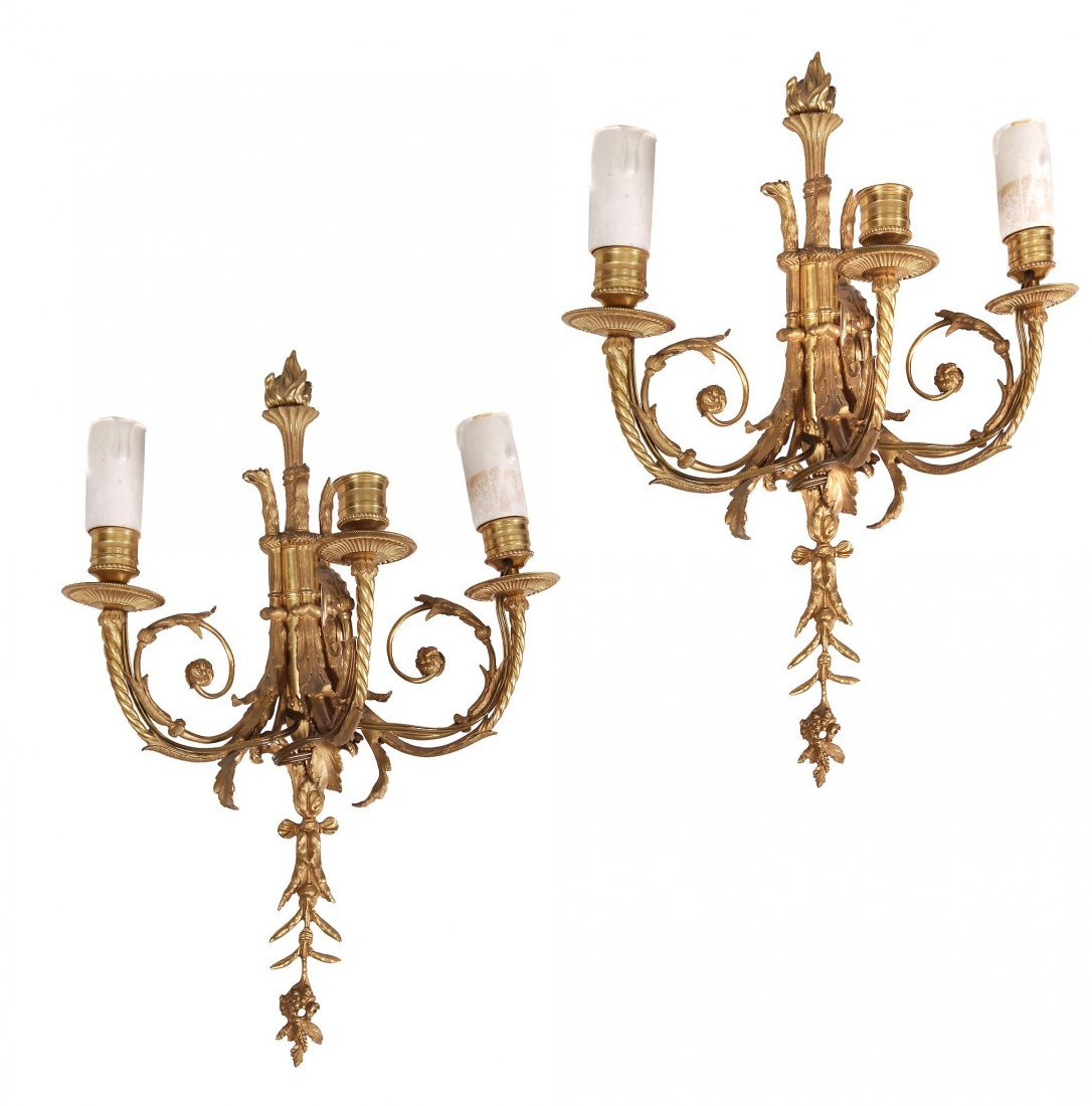A pair of gilt metal three light wall appliques in the