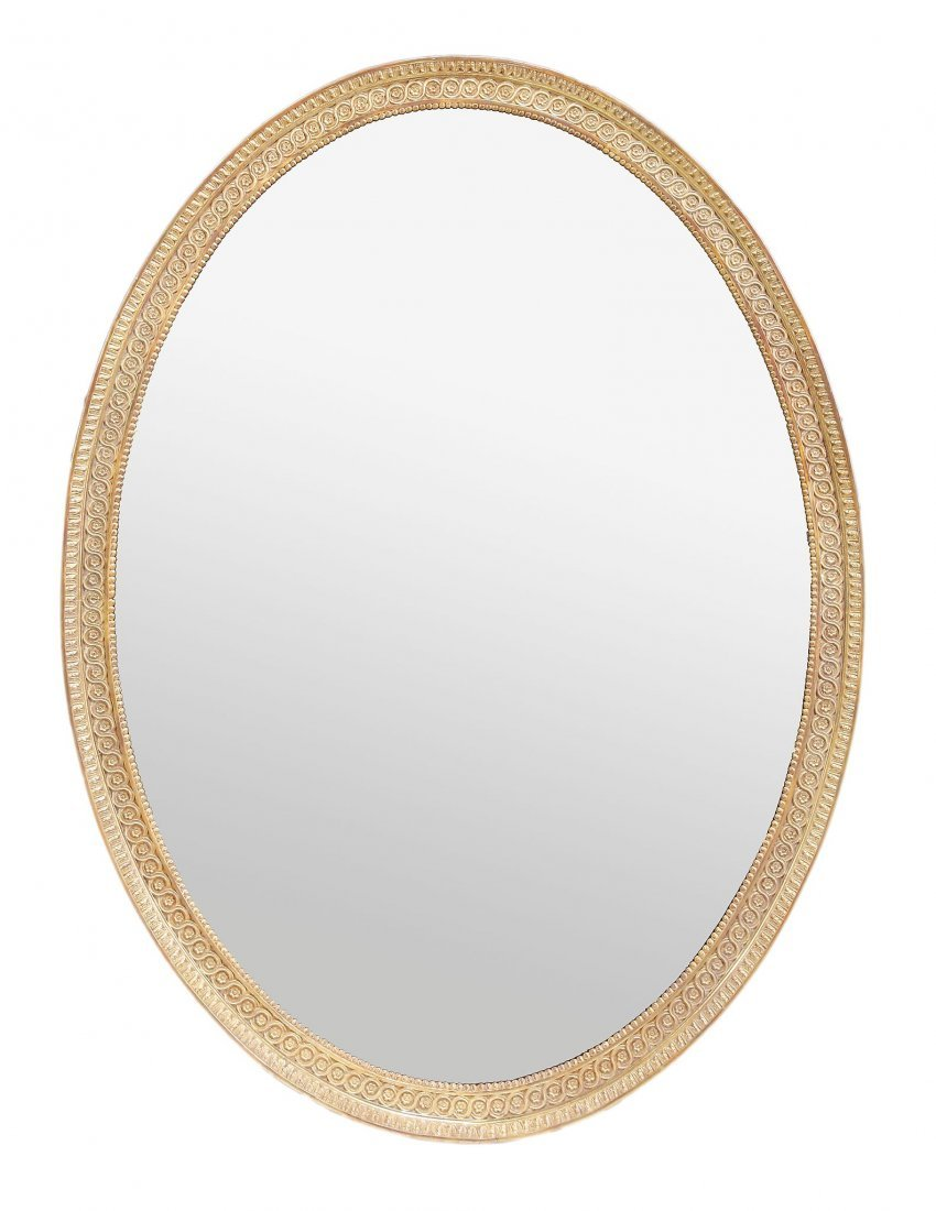 A carved giltwood and composition oval wall mirror, in