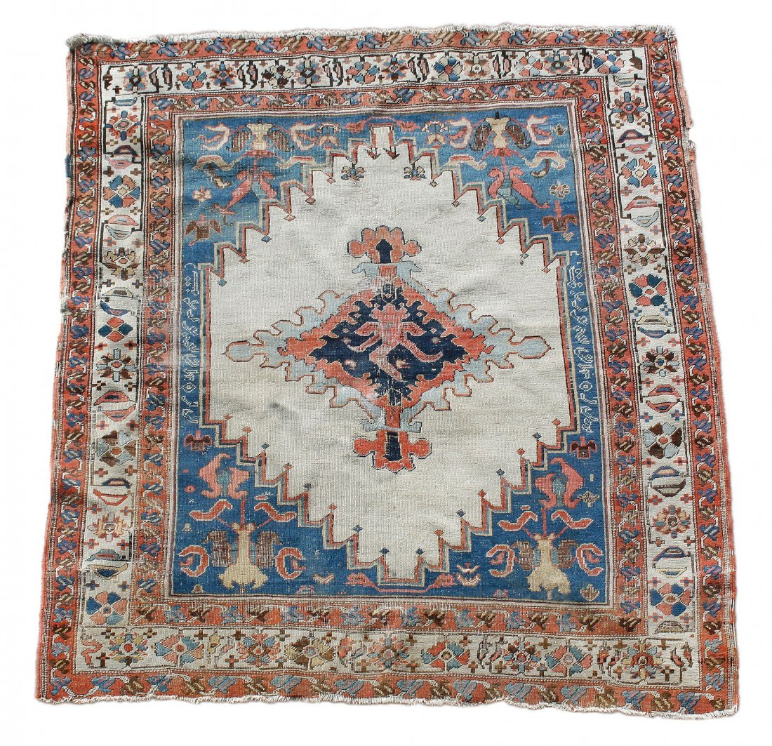 A Karachalo rug , the central ivory field with
