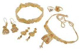 A collection of gold coloured jewellery ; comprising a
