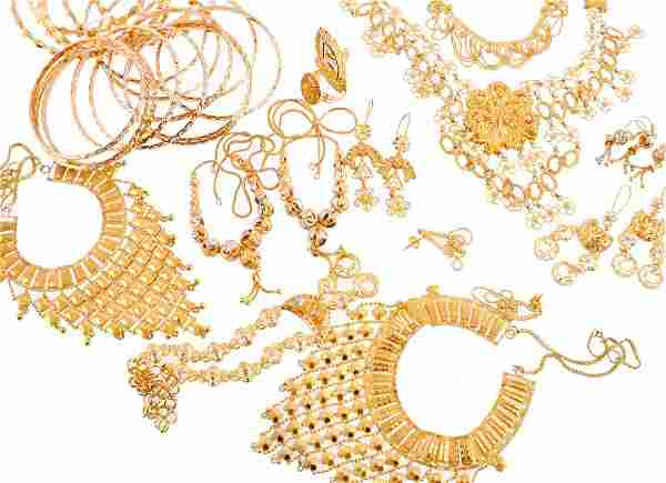 A group of gold coloured jewellery, including