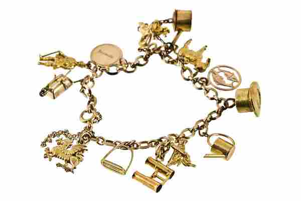 A charm bracelet, of fancy link form, with attached