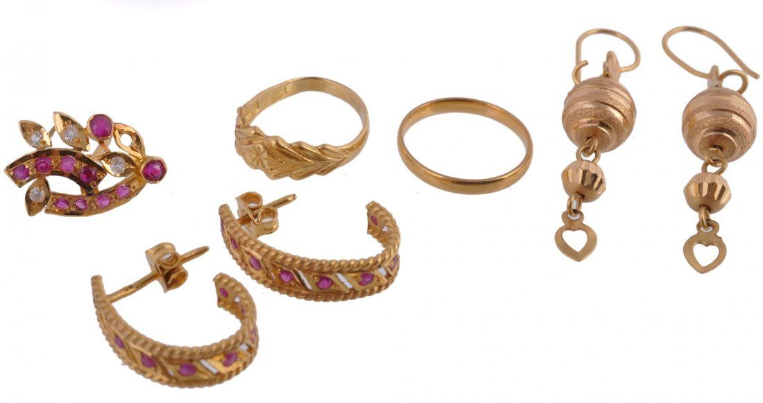 A small collection of gold coloured jewellery ,