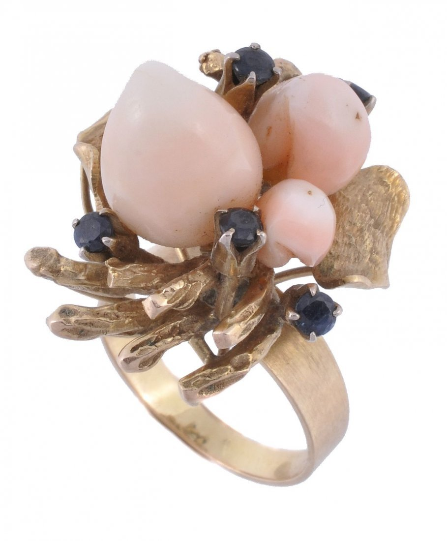 A coral and sapphire dress ring, the cowrie shell