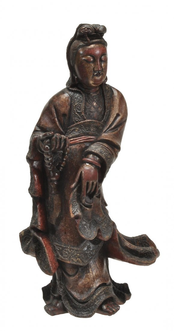 A large wood model of Guanyin , standing, clothed in
