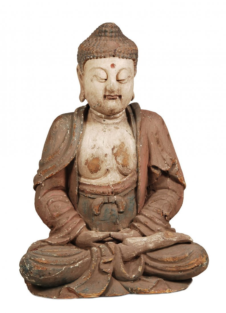 A Chinese wood figure of a Buddha , seated with crossed